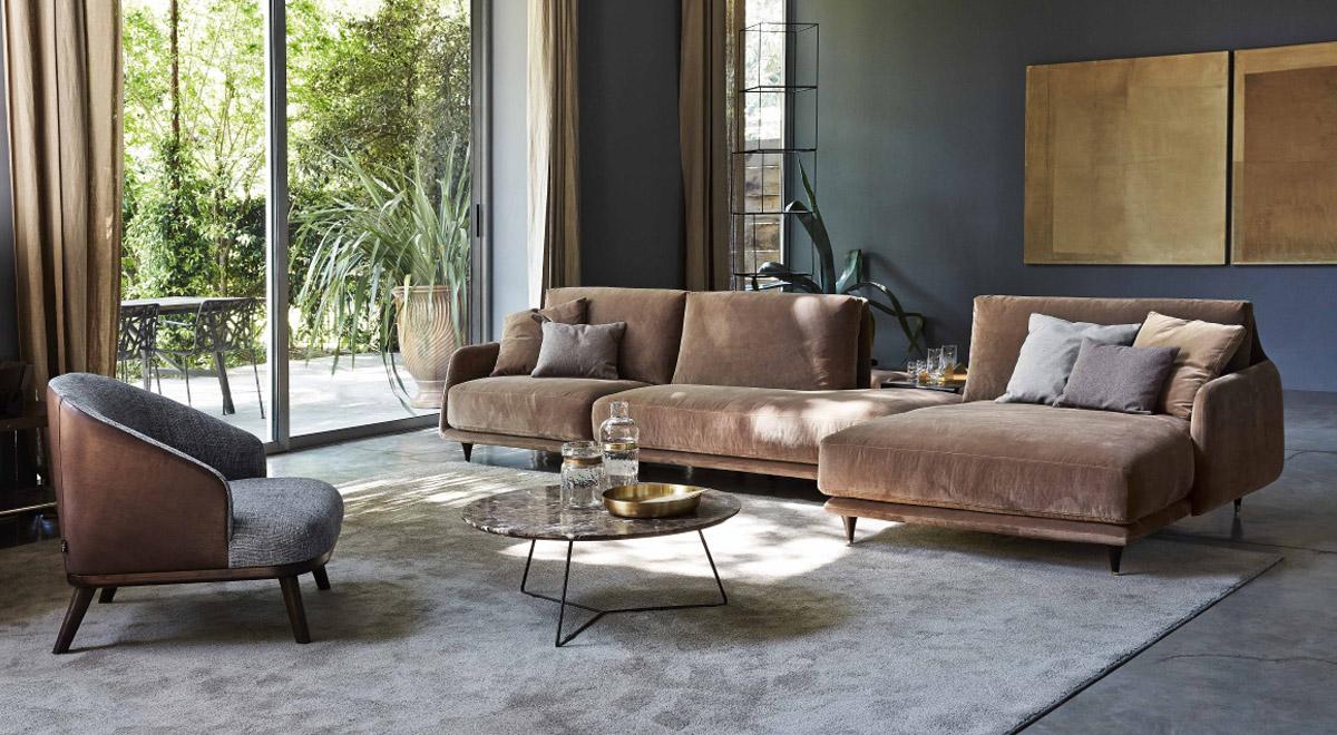 divano angolare con poltrona e tappeto